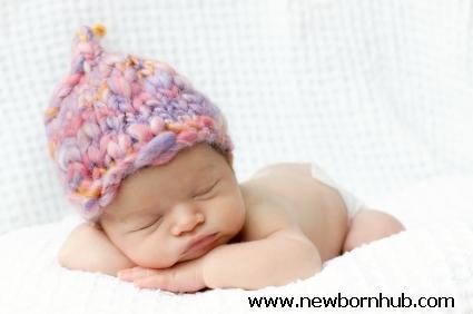 Newborn sleeping at NewbornHub.com